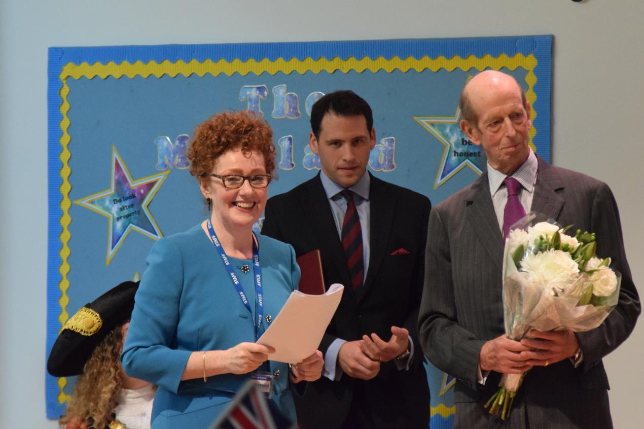 L-R_is_Moreland_Primary_School_executive_headteacher_Ann_Dwulit%2c_equerry_to_HRH_The_Duke_Of_Kent_Captain_Miguel_Holloway%2c_and_HRH_The_Duke_Of_Kent.