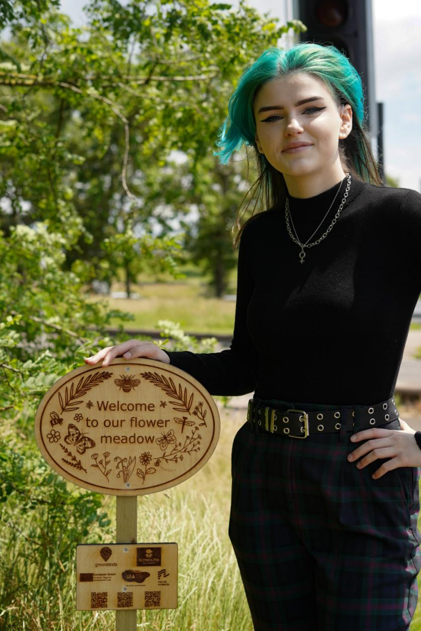 Lauren Williams with their wildflower meadow sign_Image Credit_Paul Williams