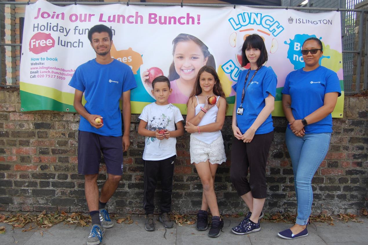 Cornwallis Adventure Playground staff (from left) Ben Bull, Jess Todd and Christina Henry, with two Lunch Bunchers