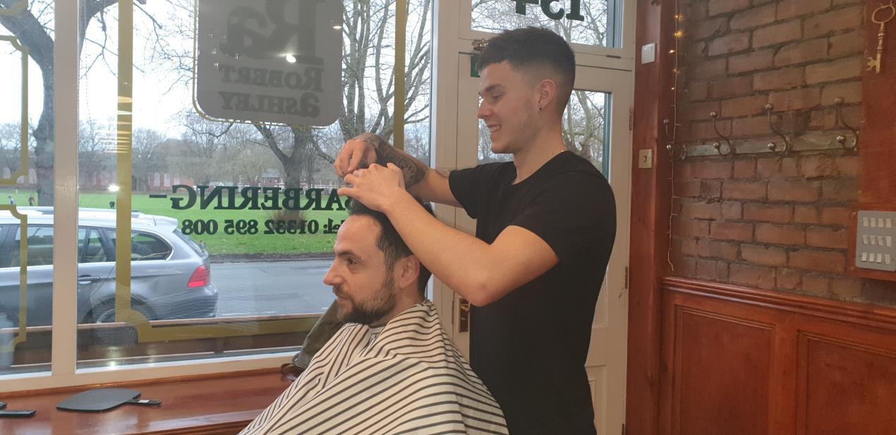 Barbering apprentice Sam Winson with boss Robert Ashley