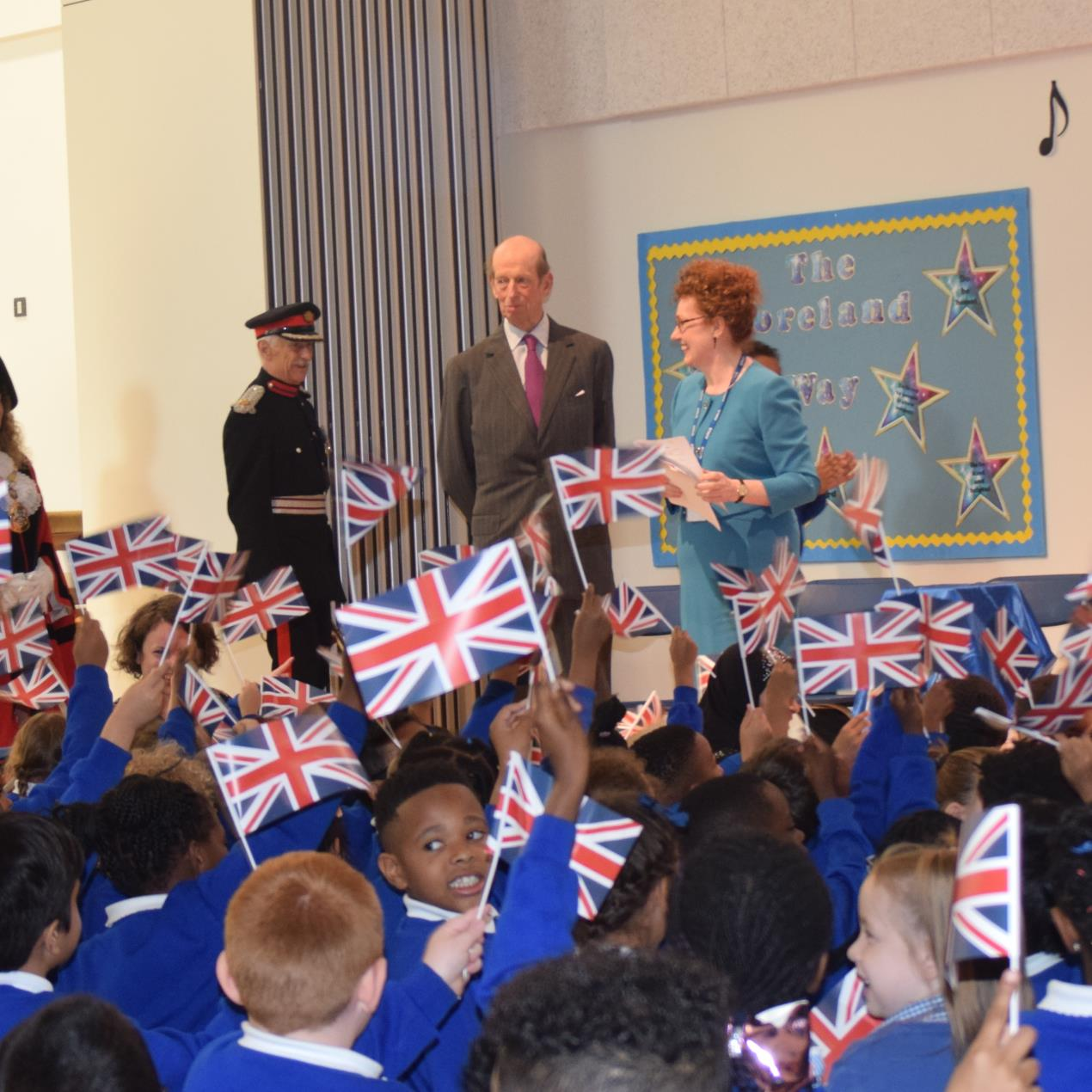L-R is Lt. Col. Roderick Morriss, Deputy Lieutenant of Hackney, HRH The Duke Of Kent and Ann Dwulit, Moreland Primary School executive headteacher