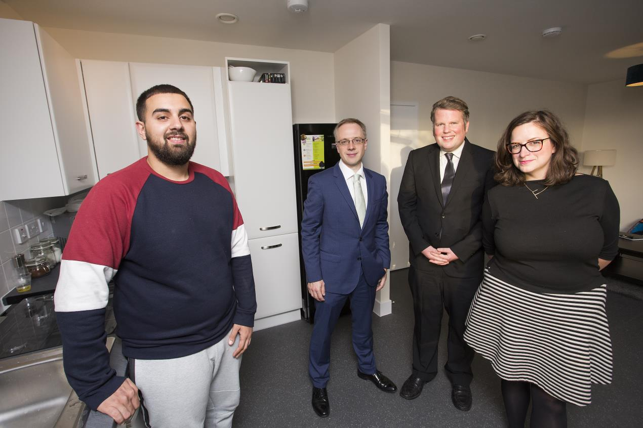 Ugur Icli (L) in his new Islington Council home