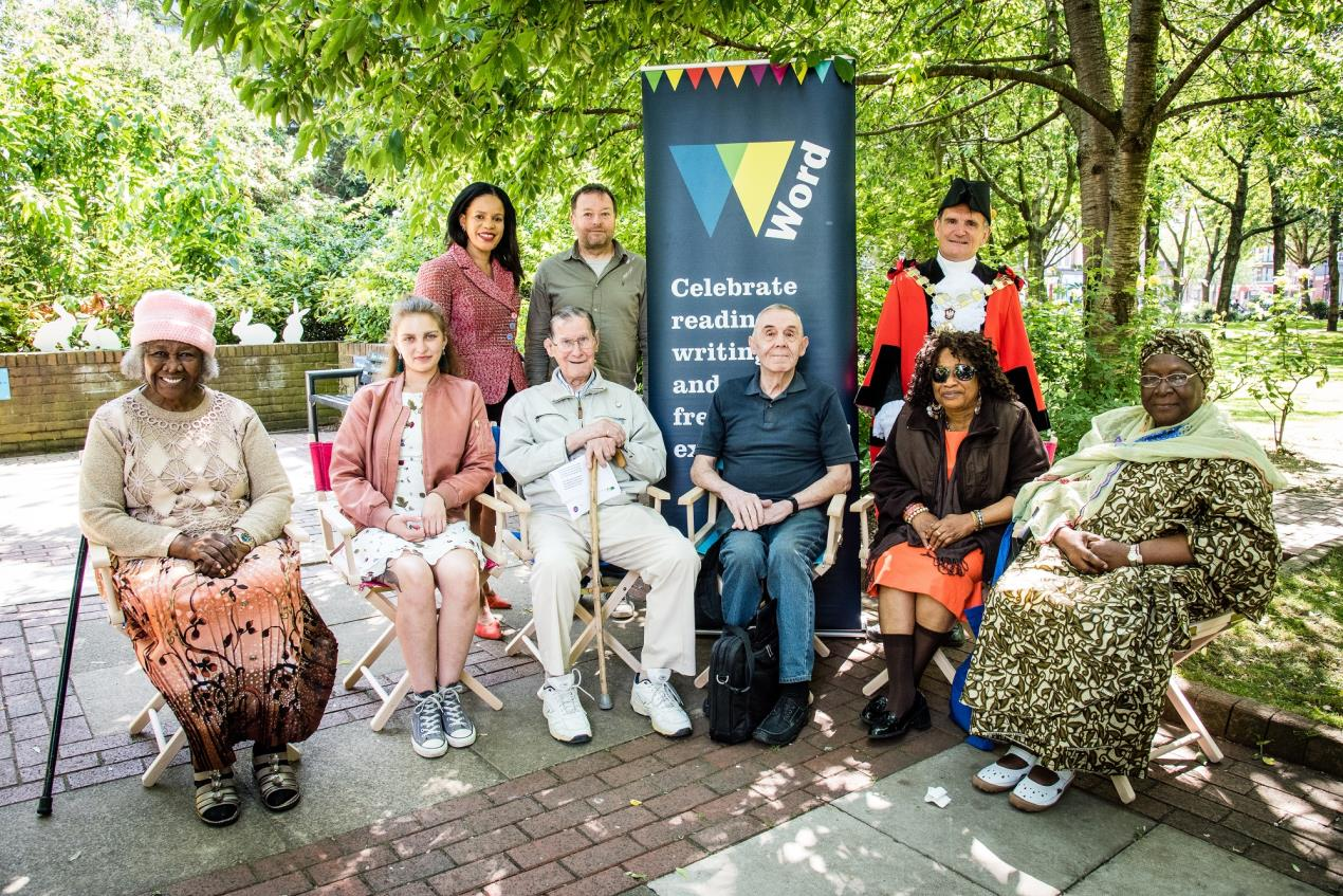 Local_residents_with_Cllr_Dave_Poyser%2c_the_Mayor_of_Islington%2c_and_Bunhill_councillor_Claudia_Webbe_(standing%2c_left)%2c_at_the_launch_of_Islington%27s_new_Word_Garden%2c_part_of_the_Word2018_Festival