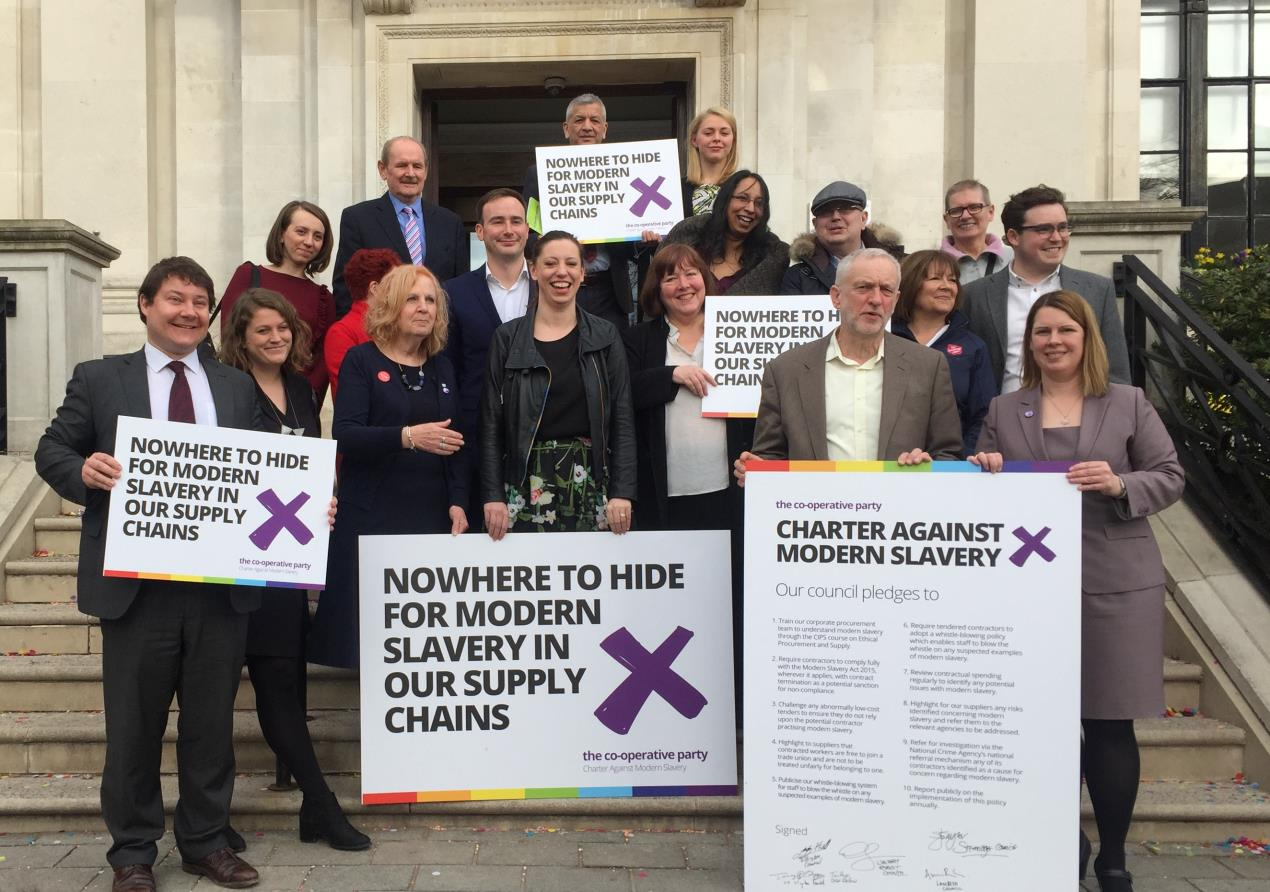 Cllr Hull (L) joins councillors and Jeremy Corbyn MP to sign the charter against modern slavery
