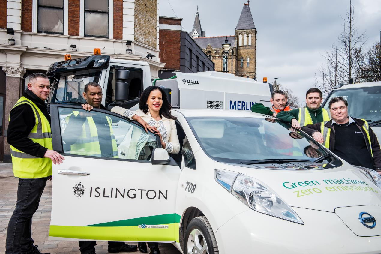 Cllr_Claudia_Webbe%2c_Islington%27s_executive_member_for_environment_and_transport%2c_in_Archway%27s_Navigator_Square_with_an_all-electric_car_and_a_street_cleaner_and_flatbed_van_powered_by_compressed_natural_gas.