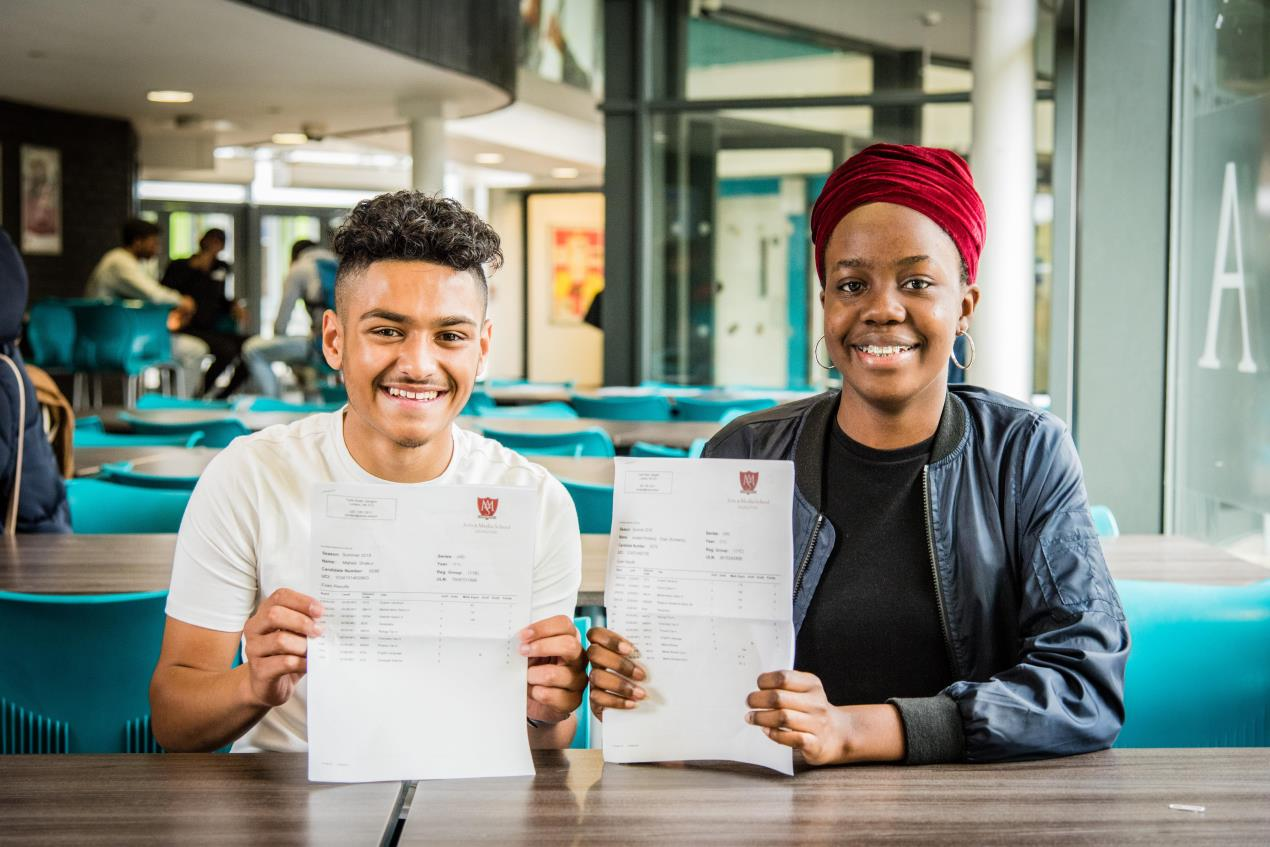 AMSI_students_Mahed_Shakur%2c_left%2c_and_Kimberly_Onen_celebrate_their_GCSE_results.