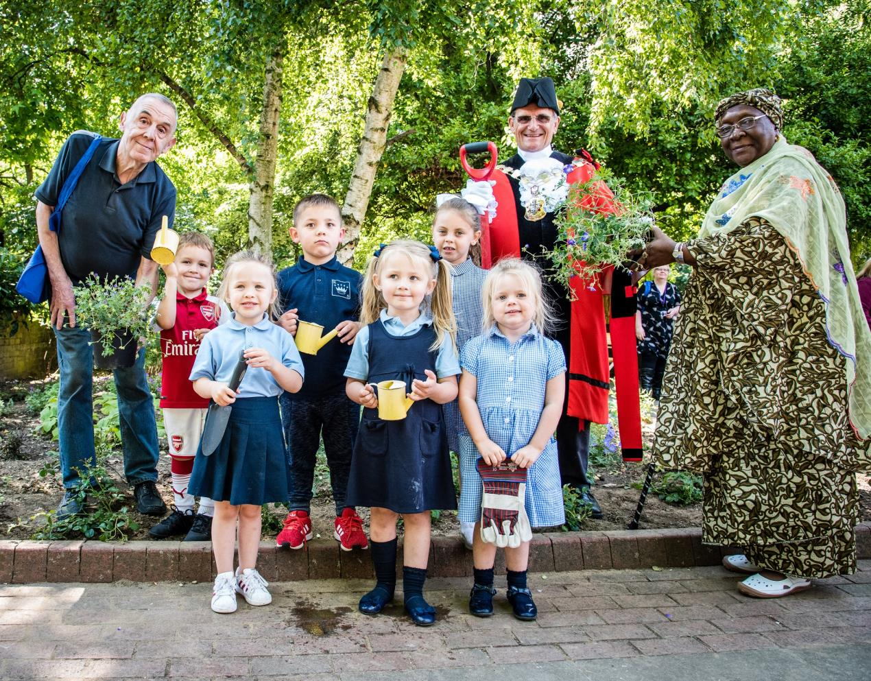 Local residents with Cllr Dave Poyser, the Mayor of Islington, at the launch of Islington's new Word Garden, part of the Word2018 Festival
