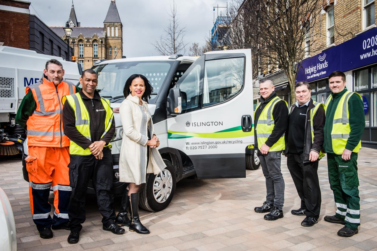 Cllr Claudia Webbe, Islington's executive member for environment and transport, in Archway's Navigator Square with an all-electric car and a street cleaner and flatbed van powered by compressed natural gas.