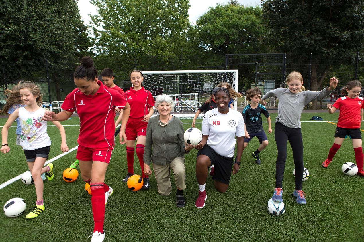 Footballers celebrate new pitch surfacing at Whittington Park
